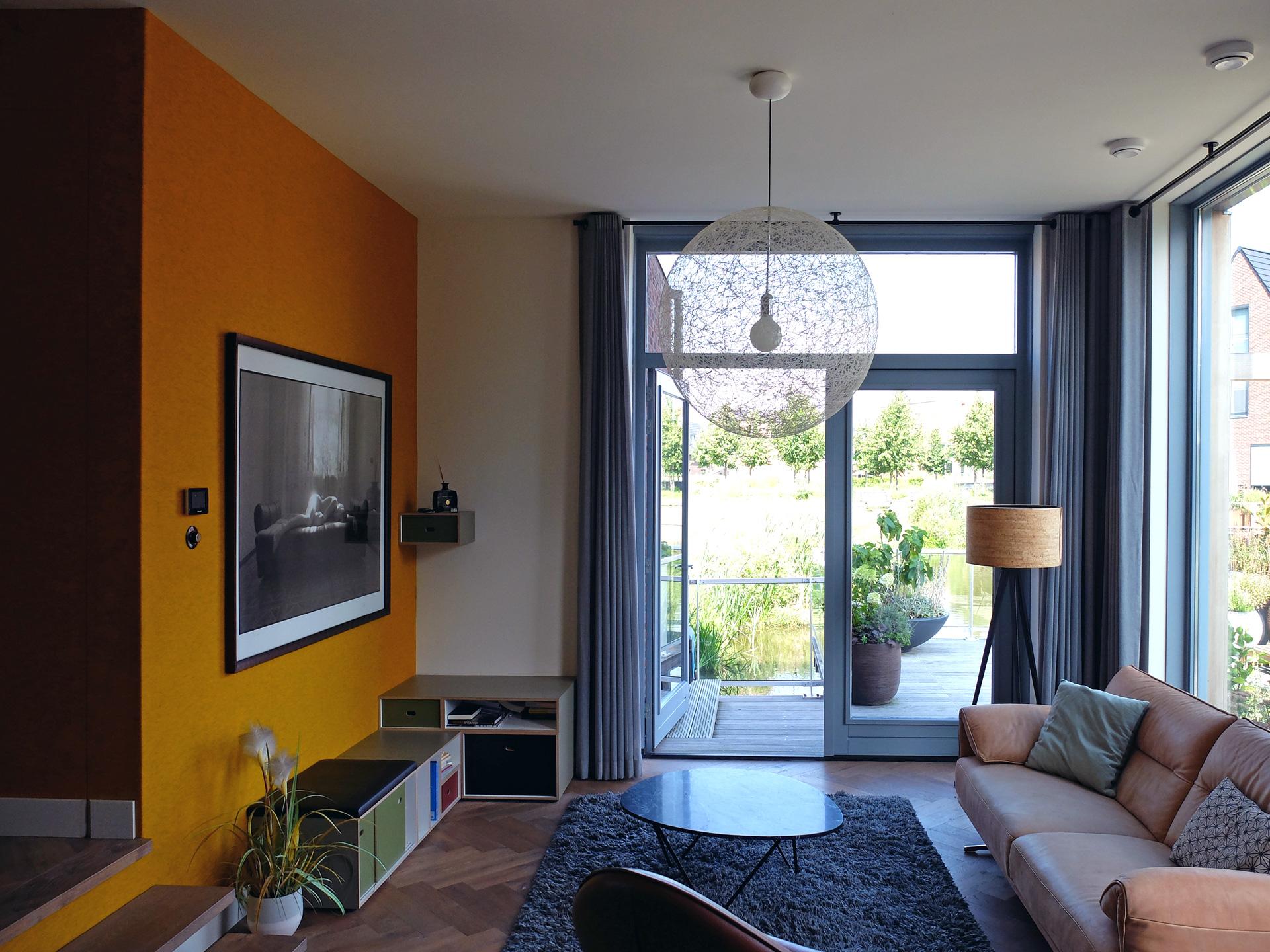 LAGADO-architects-orange-core-living-room-level-felt-residential-interior-at-home
